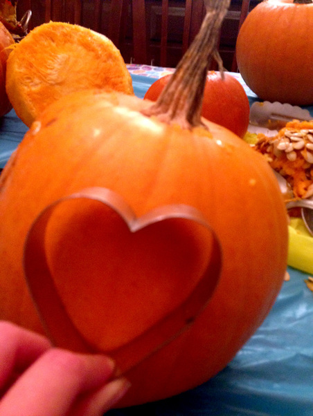 Using cookie cutters to carve pumpkins