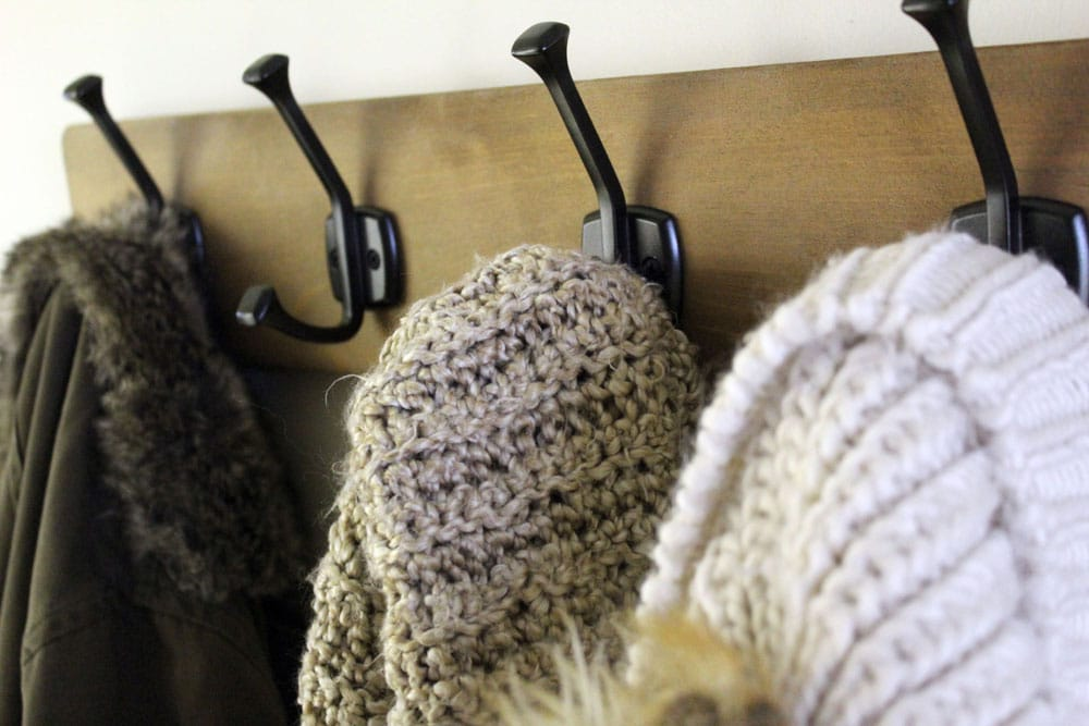 Build a wall-mounted hook rack for your entryway organization