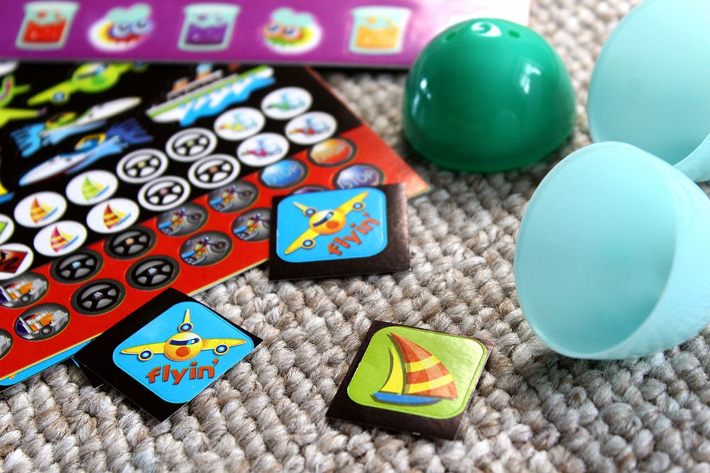 Placing stickers in Easter eggs for a fun thrifty Easter egg hunt